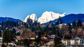 Snow covered Mount Robie Reid over the town of Mission, British Columbia, Canada. Under blue sky stock photo