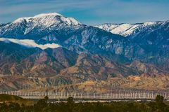 Snow Covered Mount San Jacinto. Beautiful snow-covered Mount San Jacinto rises above the Coachella Valley and San Gorgonio Pass Wind Farm, Palm Desert Royalty Free Stock Images