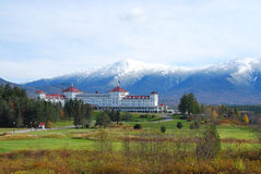 Snow covered Mount Washington. Snow capped Mount Washington and Mount Washington hotel with golf course Stock Image