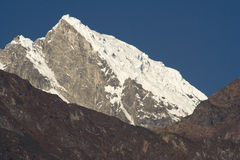 Snow covered mountain. Summit of Khatang, Nepal stock photography