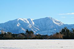 Snow covered mountain. A snow covered mountain background Royalty Free Stock Image