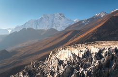 Snow-covered mountain against blue sky at sunrise. Beautiful view of snow-covered mountain against blue sky at sunrise in Nepal. Landscape with snowy peaks of Royalty Free Stock Image