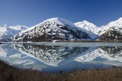 Snow covered mountain in Alaska stock images