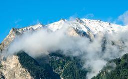 Snow covered mountain near Maienfeld under a blue sky Royalty Free Stock Image
