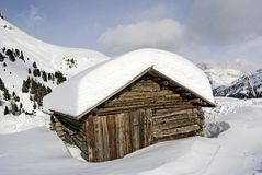 Snow covered mountain cabin Stock Images
