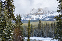 Snow Covered Mountain on a Cloudy Winter Day Royalty Free Stock Photography