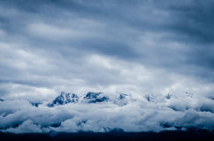Snow Covered Mountain Covered by Sea of Clouds Stock Image