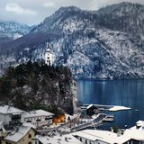 Snow Covered Mountain Houses Near Body of Water at Daytime royalty free stock image