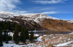 Snow Covered Mountain Lake on a Sunny Day.  Royalty Free Stock Image