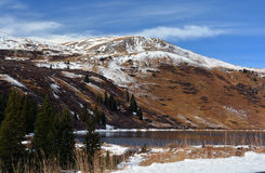 Snow Covered Mountain Lake on a Sunny Day.  Royalty Free Stock Photography