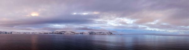 Snow covered mountain landscape in Antarctica around Cuverville Island. Royalty Free Stock Photography