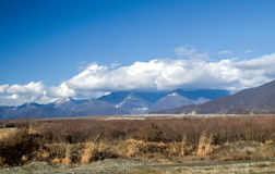 Snow covered mountain landscape, Cloudy landscape of mounatins and fields at winter time. Caucasus, Azerbaijan, Gakh Sheki Zagatal Stock Photo