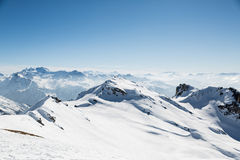 Snow Covered Mountain Landscape from a Mountain Top Stock Images