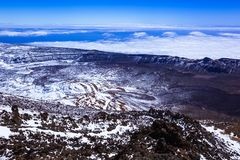 Snow-covered mountain landscape, view of the rocky landscape from the top of the mountain, volcano, clouds stock photo