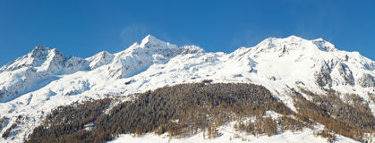 Snow-Covered Mountain Panorama. In South Tyrol, Italy, on a sunny winter day Stock Photography