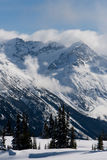 Snow Covered Mountain Peak Stock Images
