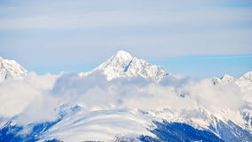 Snow-covered mountain peak in Dolomites, Italy Stock Image