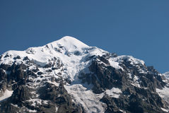 Snow-covered mountain peak Stock Images