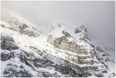 Snow covered mountain peak with little visibility due to cloud cover and snowfall. Winter, travel and inspiration concepts Royalty Free Stock Photography