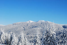Snow covered mountain peaks Royalty Free Stock Photography