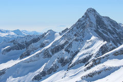 Snow covered mountain peaks. Austrian Alps. Royalty Free Stock Image