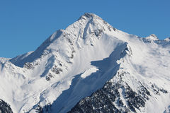 Snow covered mountain peaks. Austrian Alps. Royalty Free Stock Photo