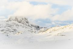 Snow coververed mountain peaks in Norway Stock Photo