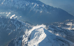 Snow-covered mountain peaks. Royalty Free Stock Photo