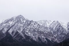 Snow covered mountain peaks, China Stock Photo