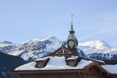 Snow-covered mountain range and church seen from the ski town of Wengen, Switzerland, Europe Royalty Free Stock Image