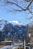Snow-covered mountain range and cog train station in Wengen, Switzerland, Europe Royalty Free Stock Photos