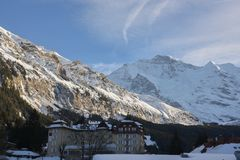 Snow-covered mountain range and holiday homes seen from the ski town of Wengen, Switzerland, Europe Stock Photography