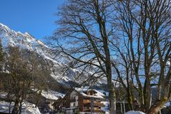 Snow-covered mountain range and holiday homes seen from the ski town of Wengen, Switzerland, Europe Stock Photos