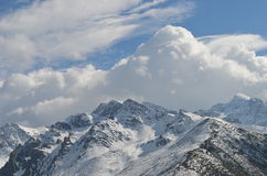 Snow covered mountain range. Panoramic view of a snow covered mountain range with dramatic cloud formations in the background, Black Sea region, Turkey Stock Images
