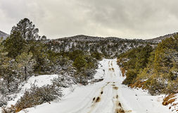 Snow covered mountain road winter landscape Stock Photography