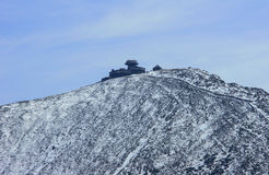 Snow-covered mountain slope and shelter Royalty Free Stock Image