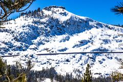 Snow Covered Mountain With Outside Train Tunnel. Snow Covered Mountain With Steep Cliffs And Outside Train Tunnel Stock Photography