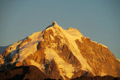Snow covered mountain at sunset light Royalty Free Stock Photos