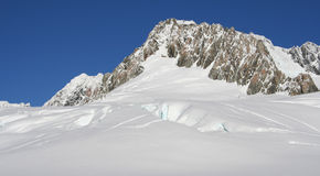 Snow covered mountain top, New Zealand. Snow covered mountain top, Franz Josef glacier, South Island, New Zealand Royalty Free Stock Photos