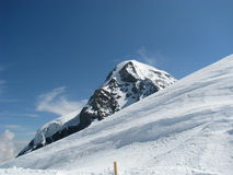 Snow covered mountain top Stock Photography