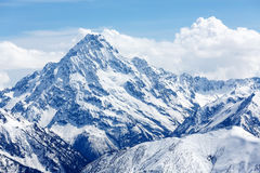 Snow-covered mountain top. Russia, Caucasus. Royalty Free Stock Image
