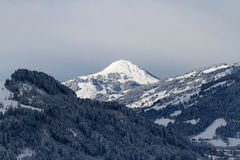 Snow covered mountain top in tirol. Hohe Salve with Brixental near Kitzbuhel Stock Image