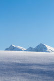 Snow covered mountain top in tirol Royalty Free Stock Photos
