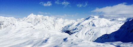 Snow Covered Mountain Under Blue Sky during Daytime Royalty Free Stock Photos