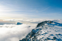 Snow Covered Mountain Under Blue and White Cloudy Skies Royalty Free Stock Images