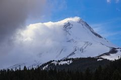 Snow Covered Mountain Under Blue and White Sunny Cloudy Sky Stock Image