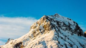Snow Covered Mountain Under Clear Blue Sky royalty free stock images