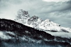 Snow Covered Mountain Under Cloudy Sky Stock Images