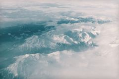 Snow Covered Mountain Under Heavy Clouds Stock Photo