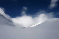 Snow Covered Mountain Under White and Blue Sky Duringdaytime Royalty Free Stock Images